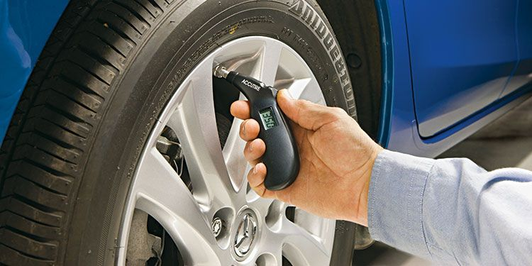 tire checking with pressure gauge