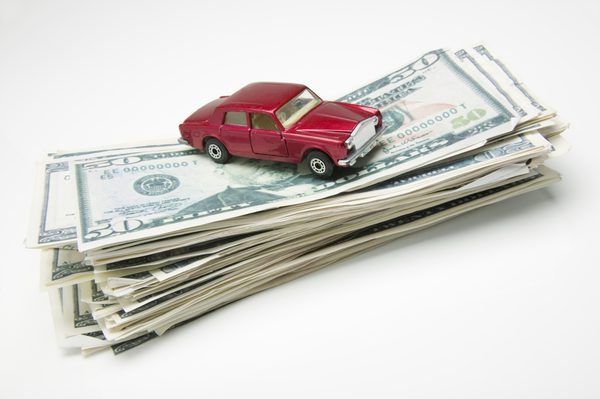 a toy car an a stack of money