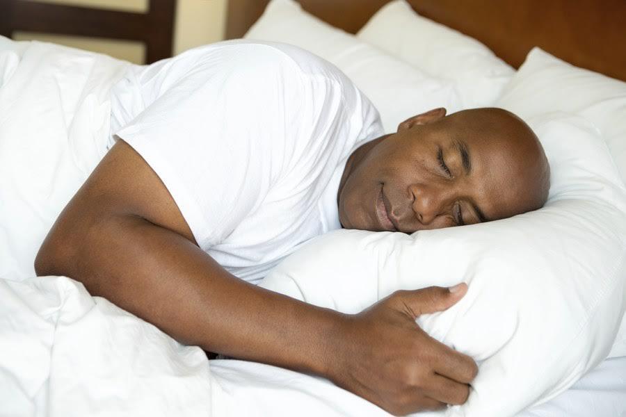 a black man sleeping tight