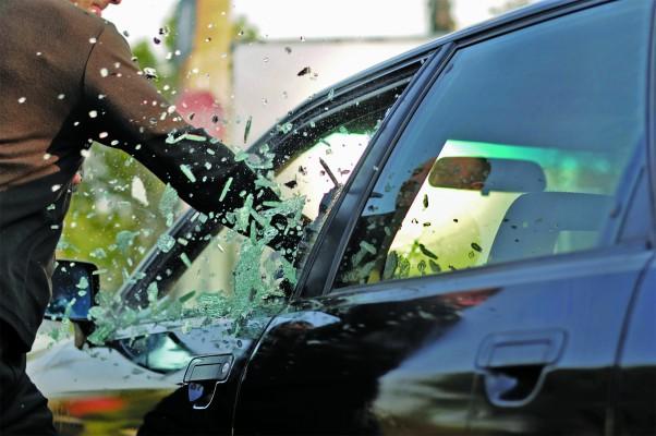 someone break the window of a car
