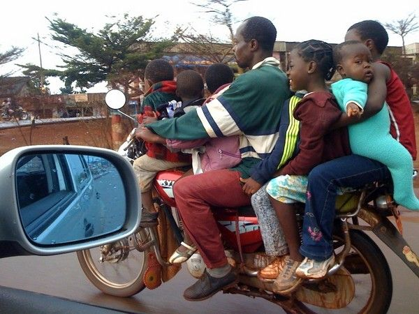 a motorbike carrying a whole family