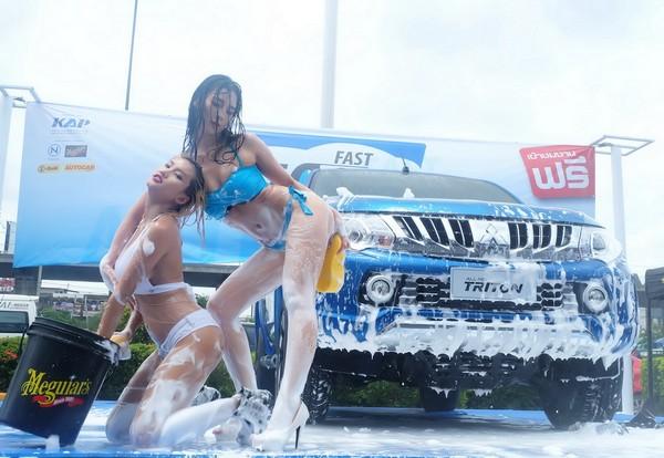 2 Asian girls washing car