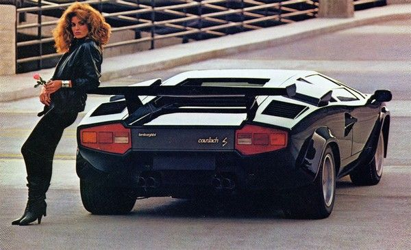 a woman posing by Lamborghini Countach