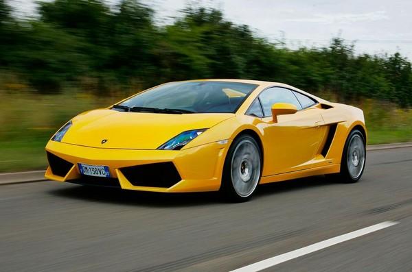 yellow Gallardo running on road