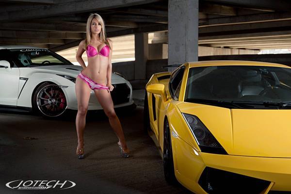 a sexy girl and a yellow Laborghini Gallardo
