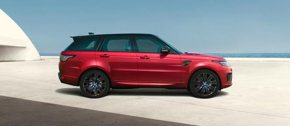 a red Land rover car