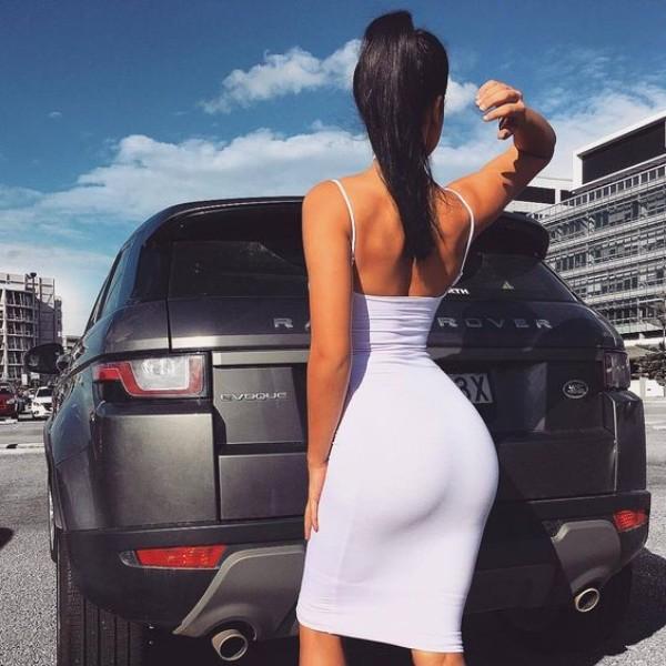 A black Land Rover Range Rover Evoque and a hot girl