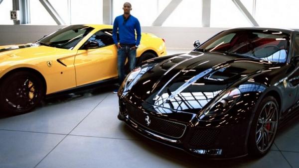 Samuel Eto'o alongside his cars