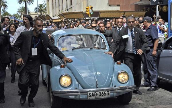 Jose Mujica escorted in his Volkswagen Beetle 1987