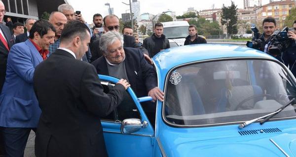 Jose Mujica in his Volkswagen Beetle 1987 let in by his escorts