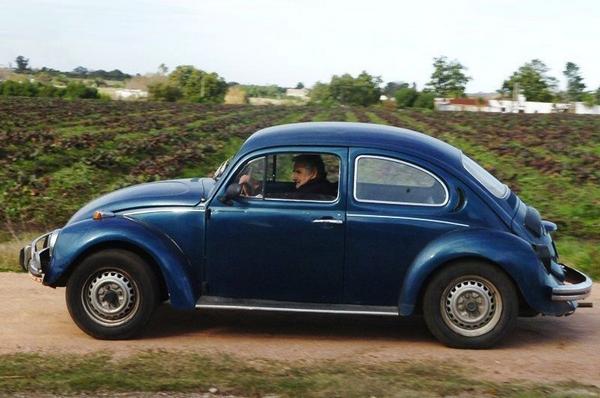 Jose Mujica behind the wheel of his Volkswagen Beetle 1987