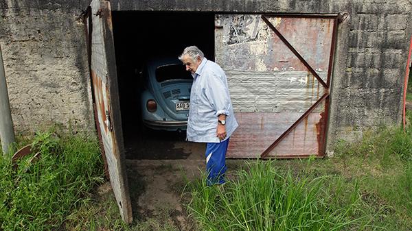 Jose Mujica parks his Volkswagen Beetle 1987 in his garage