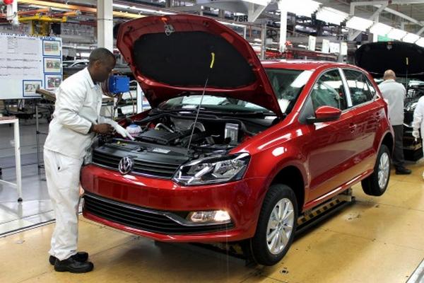 An African mechanic assembling an Volkswagen