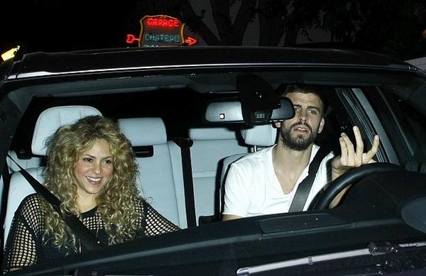 Gerard Pique behind the wheel alongside Shakira