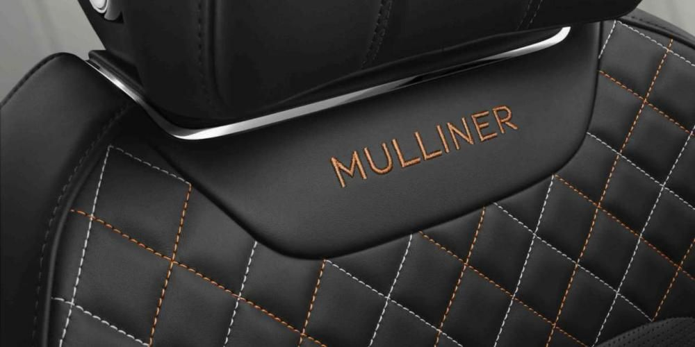 a Bentley Continental GT's seat with the word Mulliner on it
