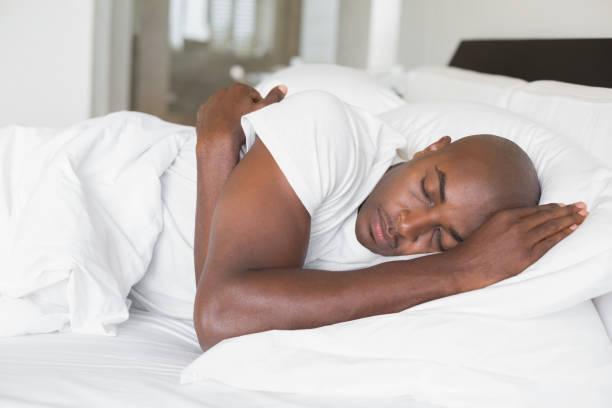 a black man sleeping