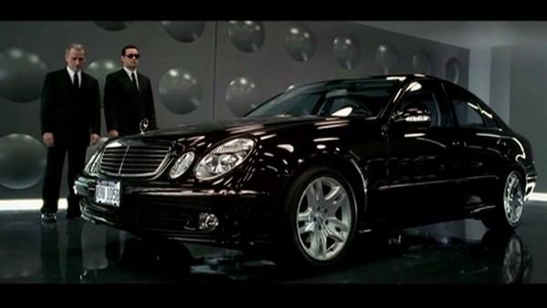 Mercedes benz E350 and 2 men in black