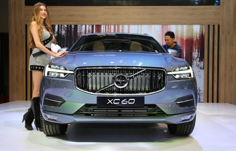 a volvo car and a attractive young lady