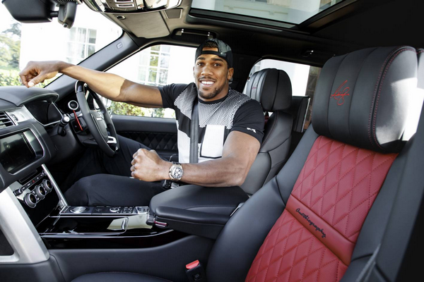Anthony Joshua behind the wheel of his personalized Ranger Rover