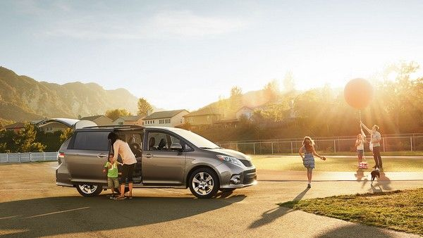 Toyota Sienna and a family