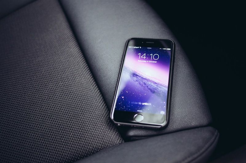a Iphone on a car seat