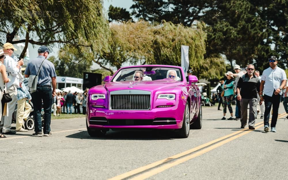 Mr. Fux driving his purple Roll Royce