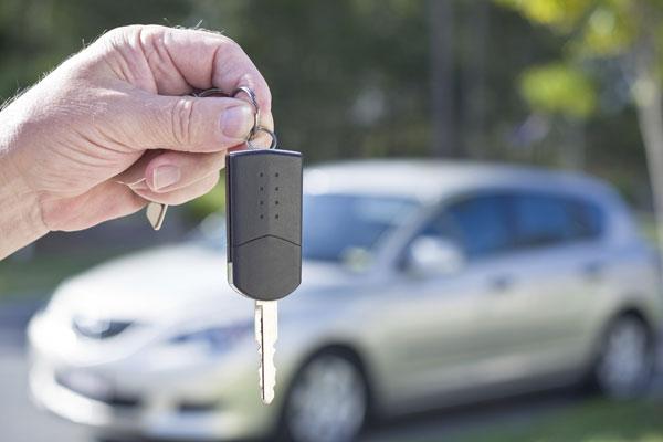a hand holding a car key