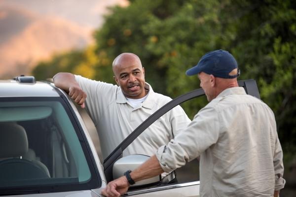 car salesmen talking