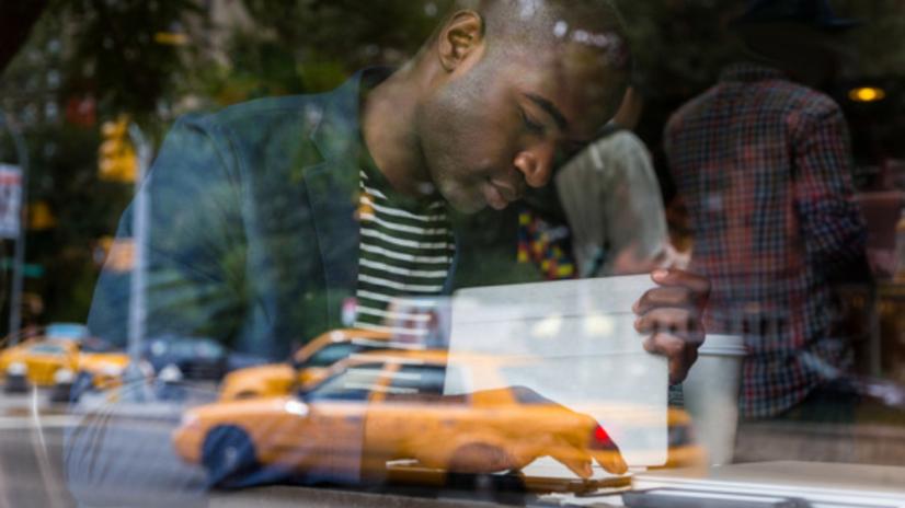 a Nigerian man contemplating