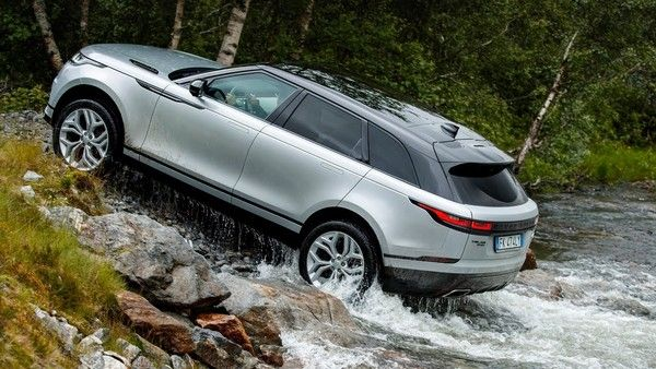 a grey Range Rover Velar off-roading