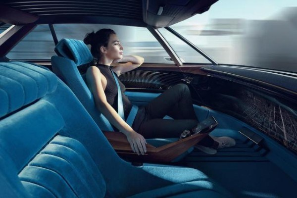 woman behind the wheel of the Peugeot e-Legend