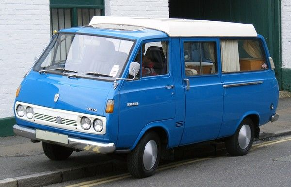 a blue first-gen Toyota HiAce