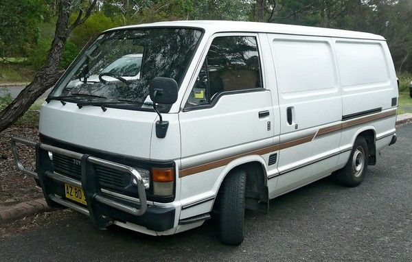 a white second-gen Toyota HiAce