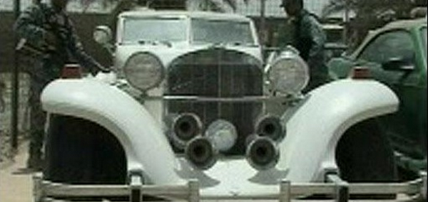 a vintage white car in Uday Saddam Hussein's car fleet