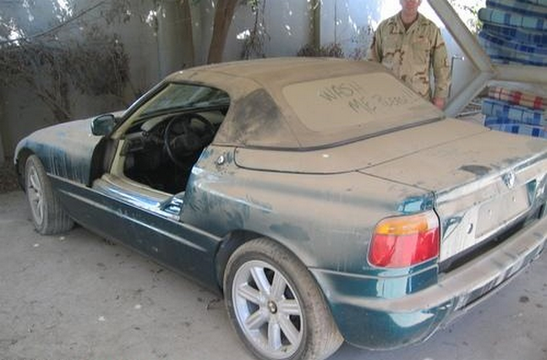 an old car with lost door in Uday Saddam Hussein's car fleet