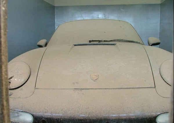 a car in Uday Saddam Hussein covered with dust
