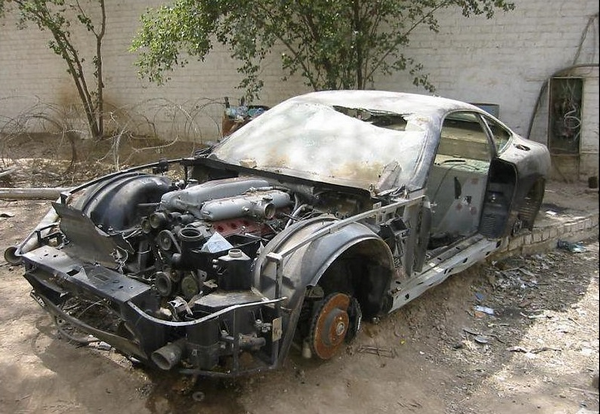 a damaged car in Uday Saddam Hussein's collection