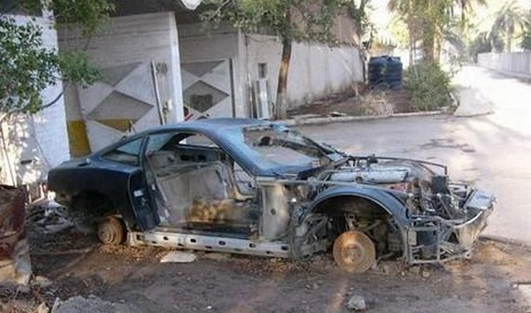 a car damaged by bombings in Uday Saddam Hussein's collection