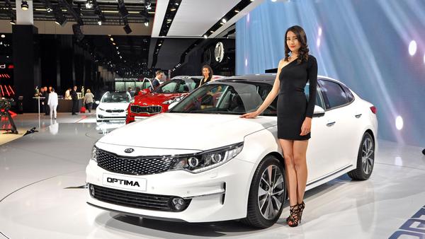 Model beside a show car at Frankfurt Motor Show