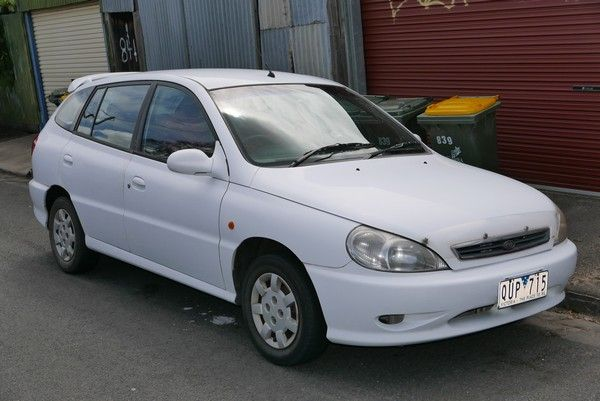 a white first-gen Kia Rio