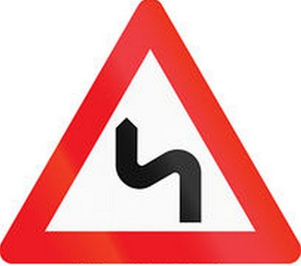 a double bend warning sign