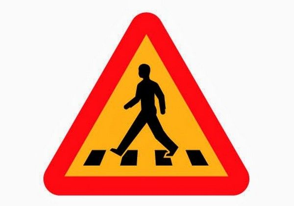 a pedestrian crossing road sign