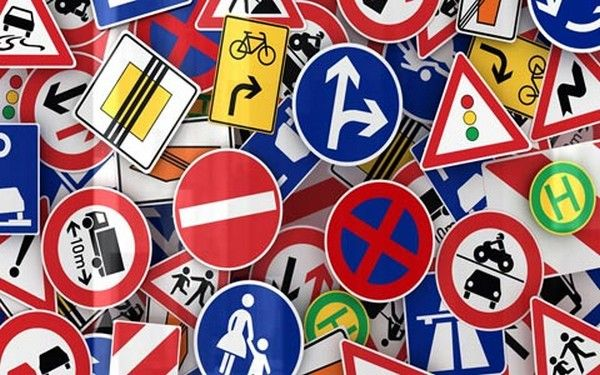 a pile of road signs