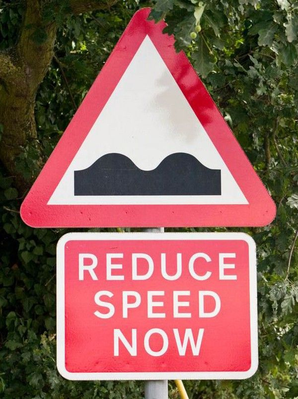 an uneven road sign
