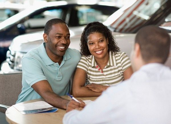2 people negotiating with car dealer