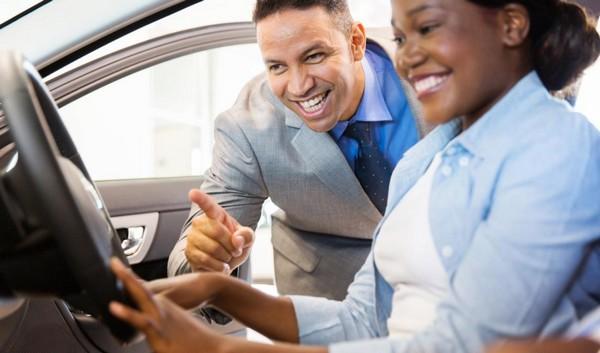 a car salesman talking to customer