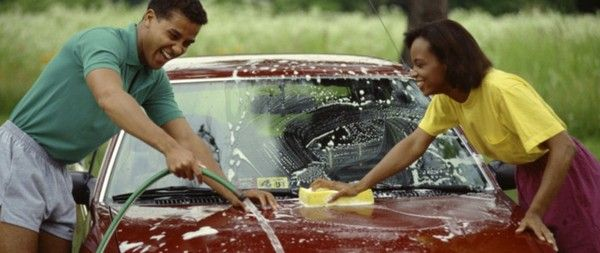 two people washing cars