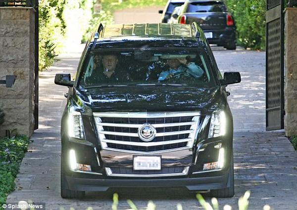American Rapper Jay-Z in his Cadillac Escalade Black