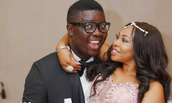 Seyi Law and his wife happily posing for photos