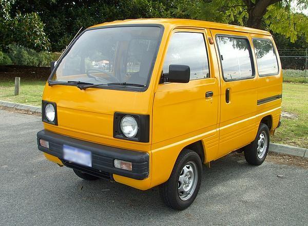 a yellow Suzuki minivan